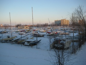 The Cooper Yacht Club, with the snow covered boats overlooking a snow covered frozen river.