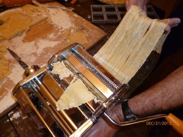 The pasta machine works very well.  It can be used to roll the pasta progressively thinner and thinner, and then cut it for the style desired, in this case, fettuccine.