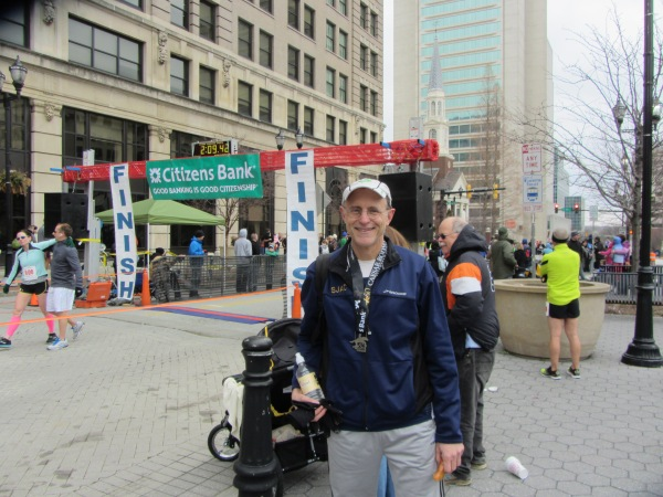 Frank, back in warm, dry clothes again, at the finish line of Caesar Rodney