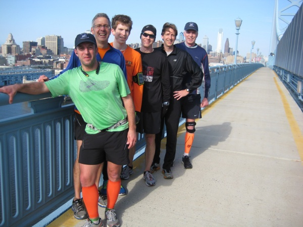 At the high point of the walkway on the south side of the Ben Franklin Bridge, with Philadelphia in the background.