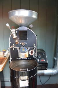 Unto the roaster it goes.  This is a small roaster for the visitors.