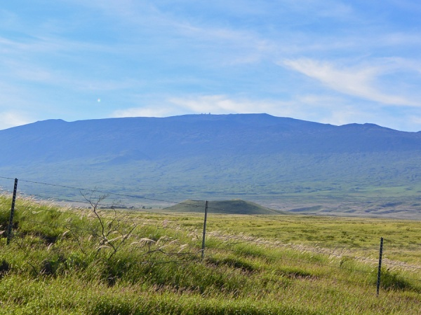 View of Mauna Kea, with observatories visible at the summit, along route 190 heading toward Waimea.