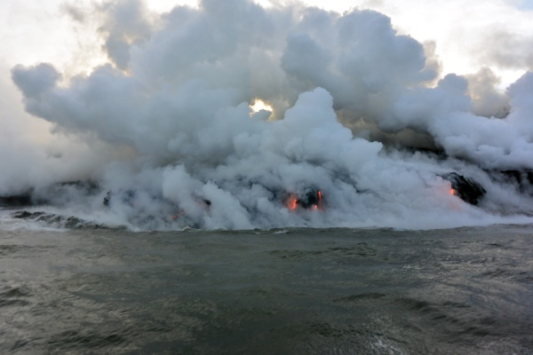 Getting close to the billowing vapor from the lava hitting the ocean water