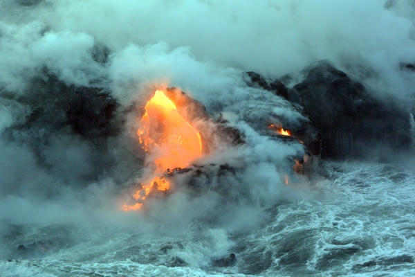The closer we got, the more the water was churning,reacting to the flow of molten rock