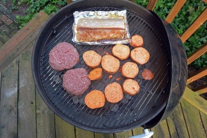 Mahi mahi sharing the grill with some bison burgers and sliced yams.