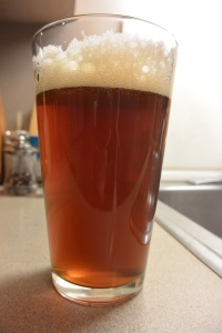Frank's Backyard Homebrew in the glass.  Nice head, nice color, very enjoyable going down.