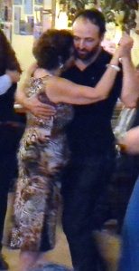 Milonguero style, or close embrace.